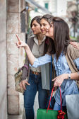 Young Women in front of a Clothing Store — Stock Photo
