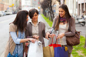 Three Beautiful Young Women doing Shopping — ストック写真