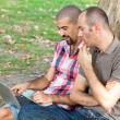 Two Men Working with Computer at Park — Stock Photo #8008811