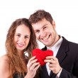 Stock Photo: Couple Holding Heart, symbol of Love, on Valentine's Day