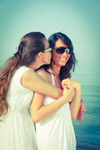 Two Female Friends Embraced on the Beach — Stock Photo