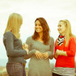 Three Women Chatting Outdoor — Stock Photo #8501434