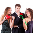 Handsome Man with two Women Flirting — Stock Photo #8501455