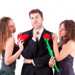Stock Photo: Handsome Man with two Women Flirting