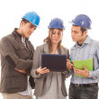 Royalty-Free Stock Photo: Engineers or Architects with Helmet on White Background