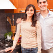 Happy Young Couple in the Kitchen — Stock fotografie #8797886