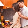 Happy Young Couple in the Kitchen — Stock fotografie #8797892