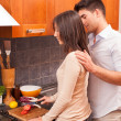 Happy Young Couple in the Kitchen — Stockfoto #8797892