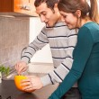 Royalty-Free Stock Photo: Wife and Husband Cooking Together in the Kitchen