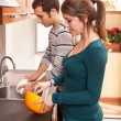Stock Photo: Wife Cooking While Husband Washing Dishes