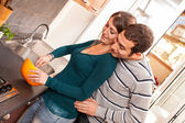 Wife and Husband Cooking Together in the Kitchen — Stock Photo