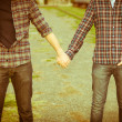 Gay Couple Outdise Holding Hands - 