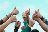 College Students with Thumbs Up — Stock Photo