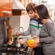 Happy Multiracial Couple in Kitchen — Stock Photo #9346570