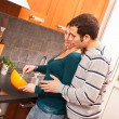 Wife and Husband Cooking Together in the Kitchen — Stock Photo #9346578