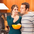 Stock Photo: WomGiving Her Husband Taste