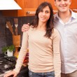 Happy Young Couple in the Kitchen — Stock fotografie #9346597