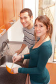 Wife Cooking While Husband Washing Dishes — Stock Photo