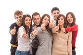快乐多种族集团与竖起大拇指 — 图库照片