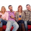 Young Group Sitting on Sofa and Drinking — Stock Photo
