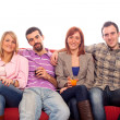 Young Group Sitting on Sofa and Drinking — Stock Photo #9627070