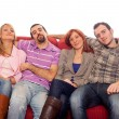 Four Boys and Girls Relaxing on Sofa — Stock Photo #9627077