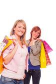 Dvě dívky s nákupní tašky — Stock fotografie