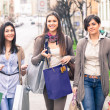 Three Beautiful Young Women doing Shopping - Stockfoto
