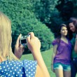 Royalty-Free Stock Photo: Girl Taking Photos to Her Friends