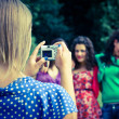 Girl Taking Photos to Her Friends — Stock Photo #9794101