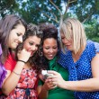Female Teenagers Looking Photos in the Camera — Stock Photo #9794108