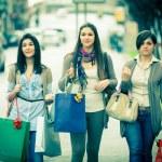 Three Beautiful Young Women doing Shopping — Stock Photo #9915145