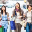 Three Beautiful Young Women doing Shopping - Stock Photo