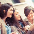 Stock Photo: Group of Women Sending Message with Mobile Phone