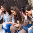 Group of Women Talking on Mobile Phone - Stock Photo