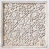 Carved ornament on the marble tile — Stock Photo