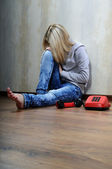 Girl and red phone. — Stock Photo