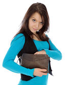 Girl looking into purse. — Stock Photo