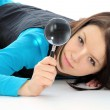 Girl with magnifying glass. — Stockfoto