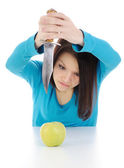 The angry girl and a fruit. — Stock Photo