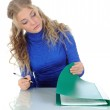 Young woman signs documents. — Stock Photo #9424648
