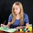 Painter at desk. — Stock Photo