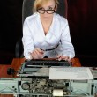 Young woman works with an old typewriter. — Stock Photo #9685415