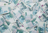 Background of thousand russian roubles bills — Stock Photo
