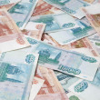 Background of one and five thousand russian roubles bills — Stock Photo