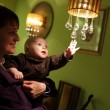 Royalty-Free Stock Photo: Child touching chandelier