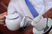 Man pouring tea — Stock Photo