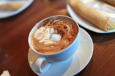 Cappuccino with sugar — Stock Photo