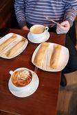 Man has breakfast — Stock Photo