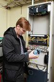 Telecom engineer holding reflectometer — Stock Photo